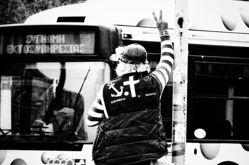 "The Political Message of a Jester  ""Freedom or Death"" - ""Sorry, Out of service"" bus At The Street of Athens, Greece 