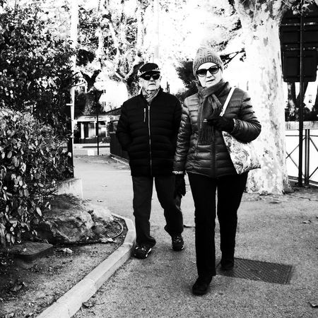 Noir Et Blanc Adult Blackadnwhite Full Length High Contrast Lifestyles Outdoors People Real People Senior Adult Standing Street Photography Streetphotography Sunglasses Togetherness Two People