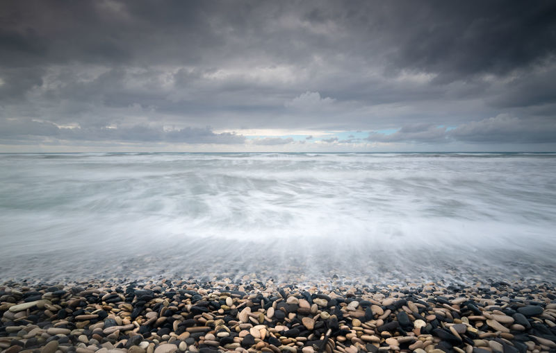 Wavy ocean and stormy sky Cloud - Sky Sea Water Sky Beach Scenics - Nature Beauty In Nature Land Rock Nature Horizon Over Water Tranquility Pebble Solid Tranquil Scene Horizon No People Stone Outdoors Storm Cloud Strormy Sky Ocean Ocean View Seascape Seaside My Best Photo