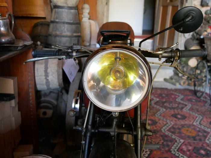 motorcycle Lighting Equipment Indoors  No People Focus On Foreground Metal Old Close-up Antique Retro Styled Headlight Built Structure Wall - Building Feature Light Bulb Day Music Hanging History Electric Lamp