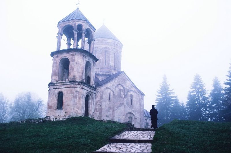 Religion Place Of Worship Spirituality Outdoors Rear View Travel Destinations Built Structure Men Day Architecture One Person Cold Temperature Sky Adult People