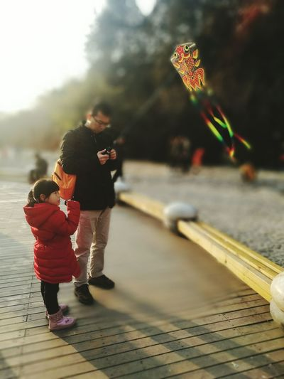 Full Length Family With One Child Family Childhood Child Males  Togetherness Father Son Leisure Activity People Parent Females Happiness Bonding Mature Adult Adult Cheerful Tradition Outdoors