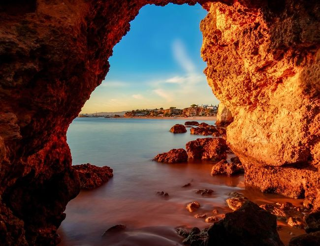 Free yourself from the cave and explore the beauty of life! Beauty In Nature Rock Formation Sky Scenics Water Tranquil Scene Tranquility Sea Rock No People Nature EyeEmNewHere Nature Photography Emotions Feeling Good Nature Lover Sea And Sky Good Vibes Nature Cloud - Sky Tranquility Golden Hour Beauty In Nature Sunlight Cave