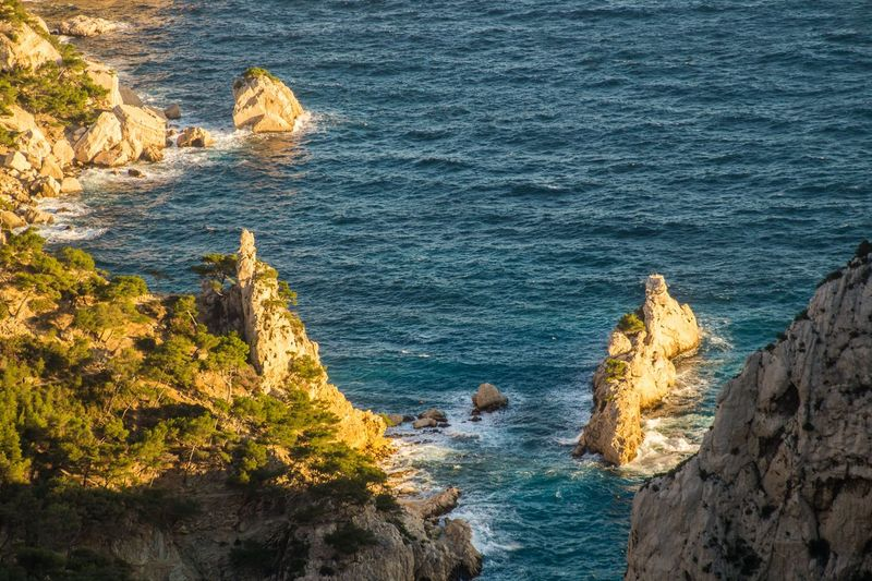 marseille,calanque,bouche du rhone, france Sea Rock Rock - Object Water Solid Rock Formation Beauty In Nature Land Beach Nature High Angle View Scenics - Nature Day No People Wave Motion Cliff Outdoors Tranquility Stack Rock Rocky Coastline