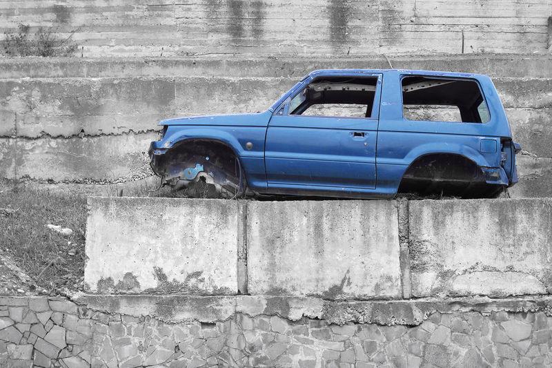 Vintage car against wall