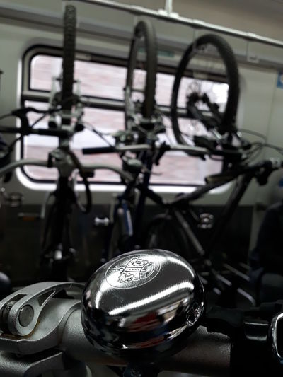 Bike Bell Bike Bell Hanging Mode Of Transportation Transportation Land Vehicle Motorcycle Metal Focus On Foreground Close-up No People Indoors  Bicycle Handlebar Day Reflection Stationary Vehicle Part Travel Equipment Silver Colored Luxury Chrome