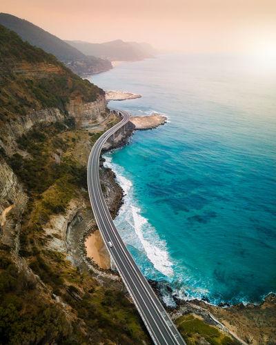 Aerial view of bridge by sea
