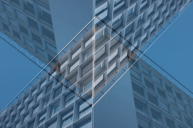 Digital composite image of modern building against clear sky