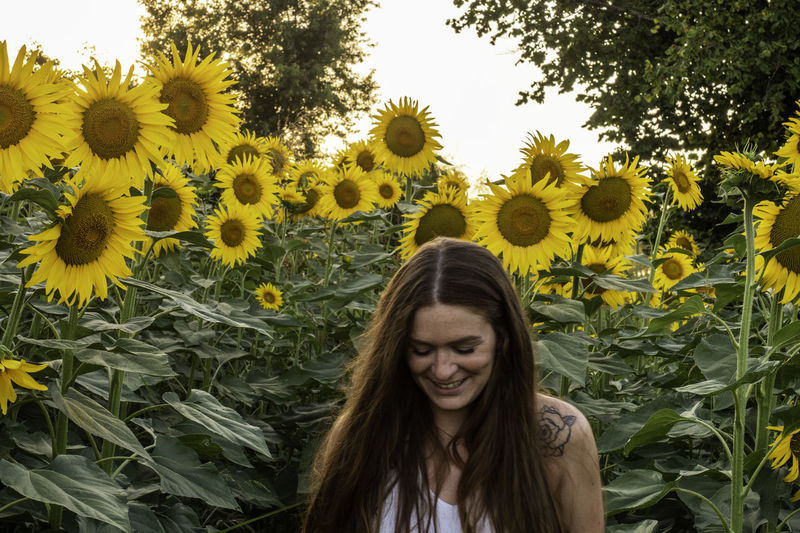 Woman Smiling While Standing At Sunflower Farm
