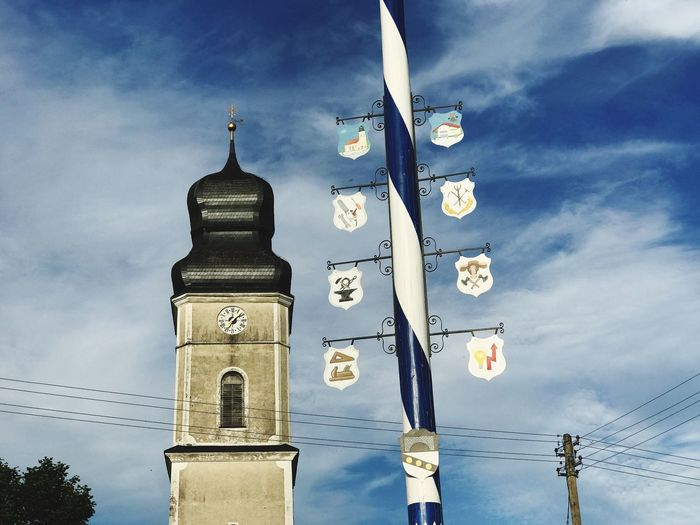 Maibaum und Kirchturm in Bayern Sky Low Angle View Cloud - Sky No People Outdoors Day Cable Religion Blue Built Structure Architecture Building Exterior Nature Tree GERMANY🇩🇪DEUTSCHERLAND@ Bavaria Tradition Tradition Typical Religion Travel