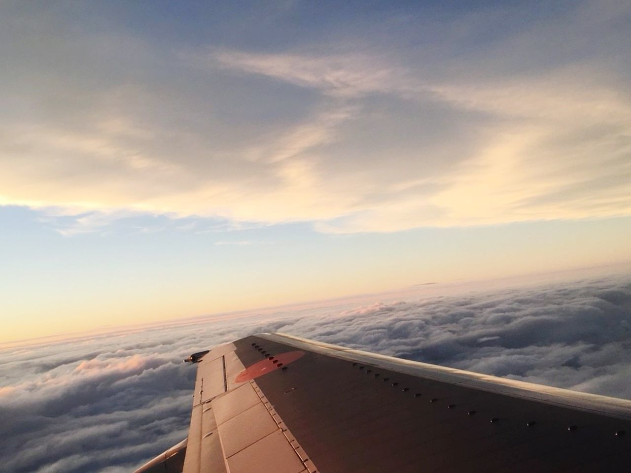 airplane, transportation, cloud - sky, sky, air vehicle, journey, mode of transport, aerial view, aircraft wing, cloudscape, airplane wing, no people, travel, beauty in nature, nature, jet engine, sunset, scenics, mid-air, outdoors, flying, vehicle part, day, water
