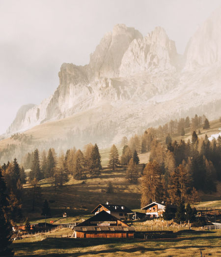 Mountain Architecture Built Structure Scenics - Nature Building Exterior Building Environment Sky Beauty In Nature Nature Landscape Mountain Range No People House Tree Plant Cold Temperature Day Land Outdoors Snowcapped Mountain Mountain Peak