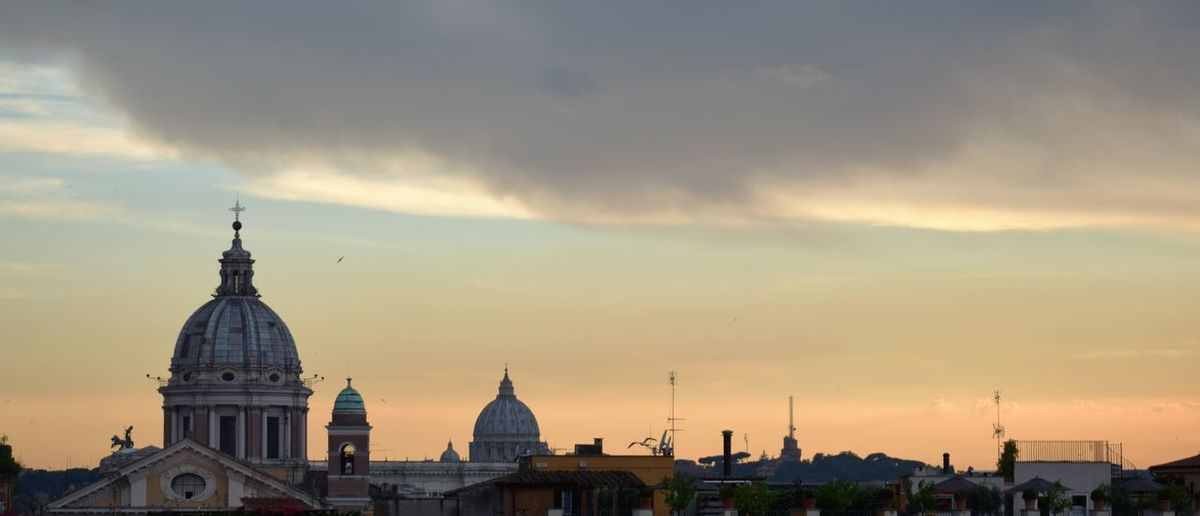 Cathedral against st peter basilica at sunset
