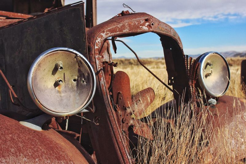 Close-up of abandoned truck on field