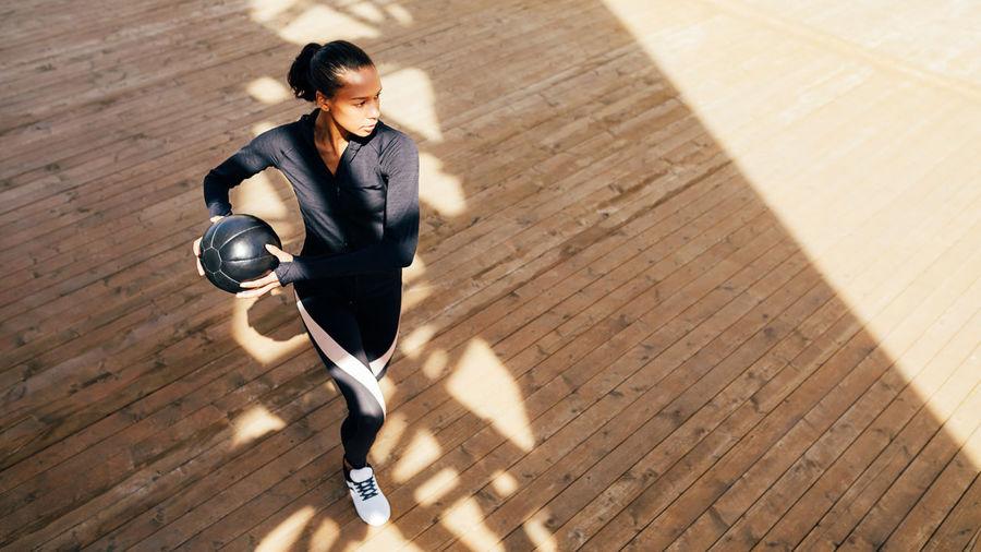High Angle View Of Woman On Hardwood Floor