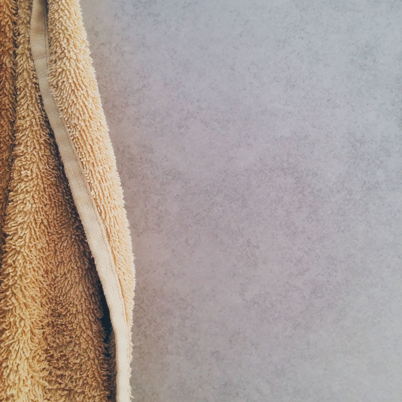 Cropped image of towel hanging on wall at home