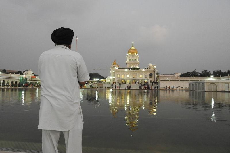Gurudwara Guru Nanak Golden Temple Delhi Waheguru Khalsa Streetphotography Bestdelhi EyeEm Selects Politics And Government City Water Men Standing Full Length Rear View Cityscape Sky Architecture