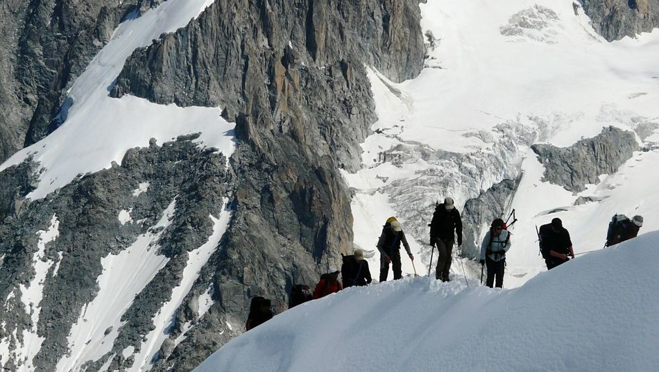 Standing on the edge of a cliff Chamonix-Mont-Blanc Mountain Climbing Hiking Group Cold Mountains Mountain View