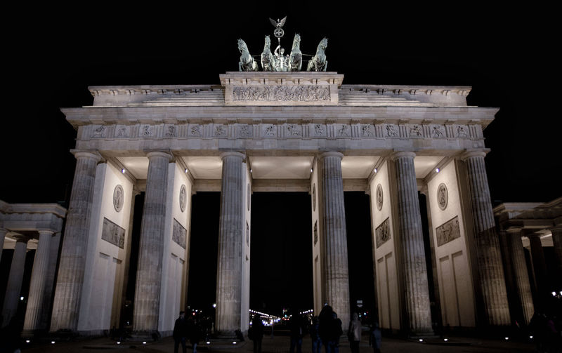 branderburger Ancient Architectural Column Architecture Building Exterior Built Structure City City Gate Discover Berlin History Illuminated Large Group Of People Low Angle View Monument Night Outdoors People Real People Sculpture Sky Statue Tourism Travel Travel Destinations Triumphal Arch