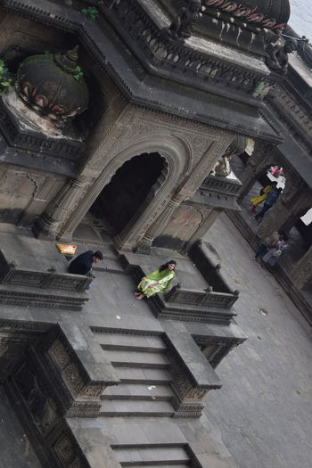 High angle view of people on steps of building
