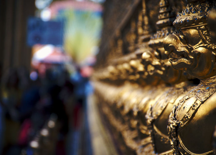 Garuda guard on the Emerald Temple Sculpture Statue Art And Craft Representation Spirituality Religion Belief Close-up Gold Colored Place Of Worship Building No People Ornate Thailand