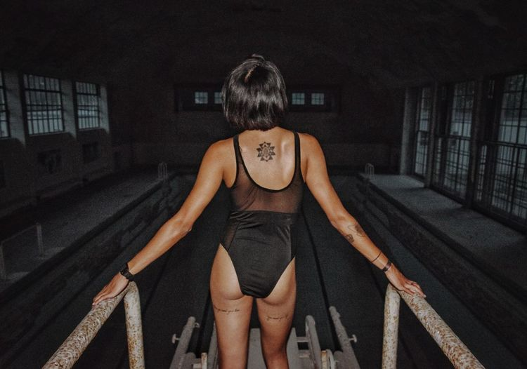 Its more exciting when it's forbidden One Person Adult Only Women Front View People One Woman Only Human Body Part Day One Young Woman Only Young Adult Sky Athlete Swimming Pool Swimwear Swimsuit Black Berlin Beauty Indoors  Girl Back Pool Tattoo Dark The Week On EyeEm