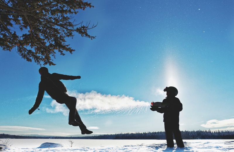 Snow Patrol Canada Ice Nature People Play Playing Sky Snow Two People Water Water Gun Winter