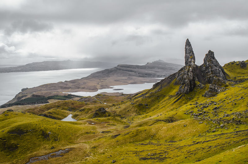 Scenic View Of Old Man Of Storr Against Cloudy Sky