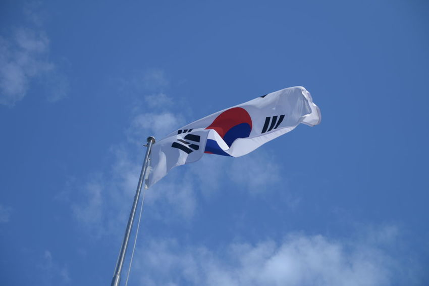 Flag Sky Patriotism Low Angle View Wind Environment Blue Cloud - Sky Nature Pole Waving Day Motion White Color No People Red Freedom Emotion National Icon Independence Korean Flag