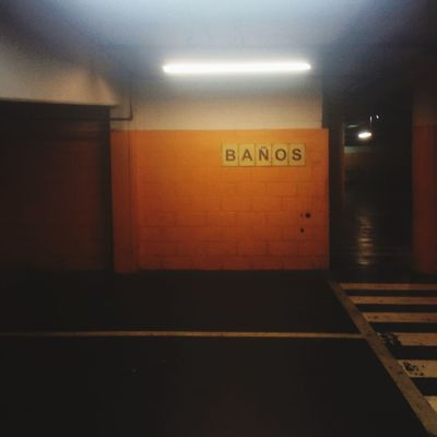 Yellow Wall Textures and Surfaces color palette Typography Sign Illuminated Public Transportation Architecture Indoors  Communication Subway No People Built Structure Lighting Equipment Flooring Text Transportation Symbol Ceiling Wall - Building Feature