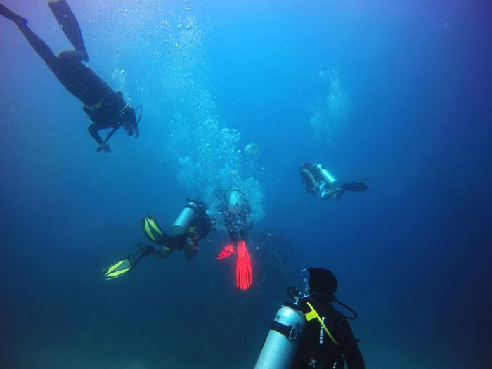 People scuba diving at mabul island