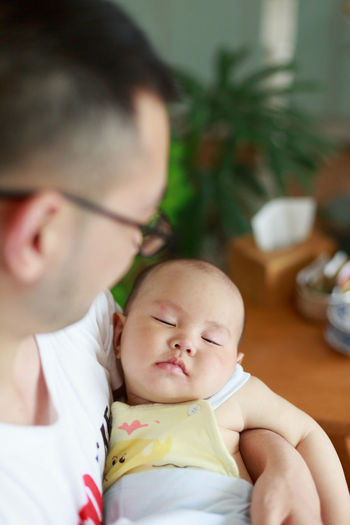 Baby Babyhood Bonding Care Childhood Close-up Cute Day Family Family With One Child Food Fragility Headshot Holding Indoors  Lifestyles Love New Life Place Of Heart Real People Togetherness Young Adult