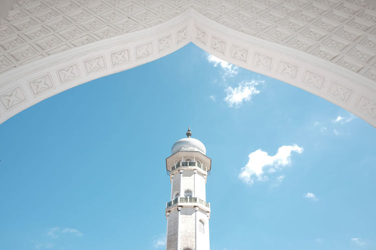 Low angle view of historical mosque building against sky