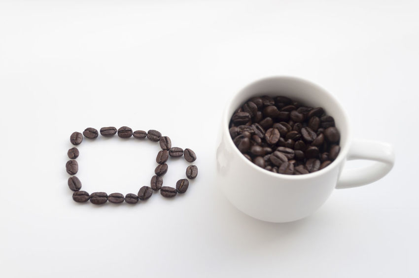 Brown Close-up Coffee Coffee Beans Cup Cute Freshness Heart Shape Indoors  Isola No People Studio Shot Table White White Background White Cup