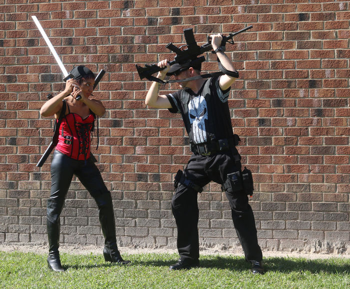 Brick Wall Comiccon Comicon Costume Costumes Man With Gun Outdoors Punisher The Punisher Woman With Sword