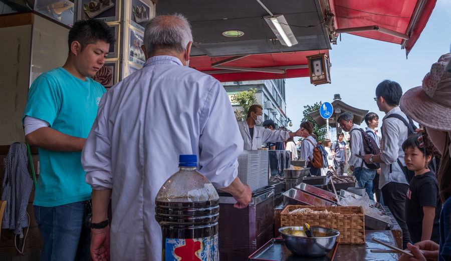 Group of people at market stall
