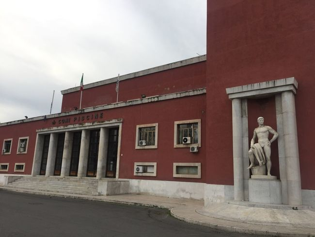Rome, Italy - January 7, 2017: Coni swimming center exterior at Foro Italico. Coni is the Italian National Olympic Committee Fascism Architecture Rome Architecture Art And Craft Building Exterior Built Structure Coni Fascistarchitecture Foro Italico Italian No People Olympic Committee Outdoors Sculpture Statue Swimming Pool Villaggioolimpico