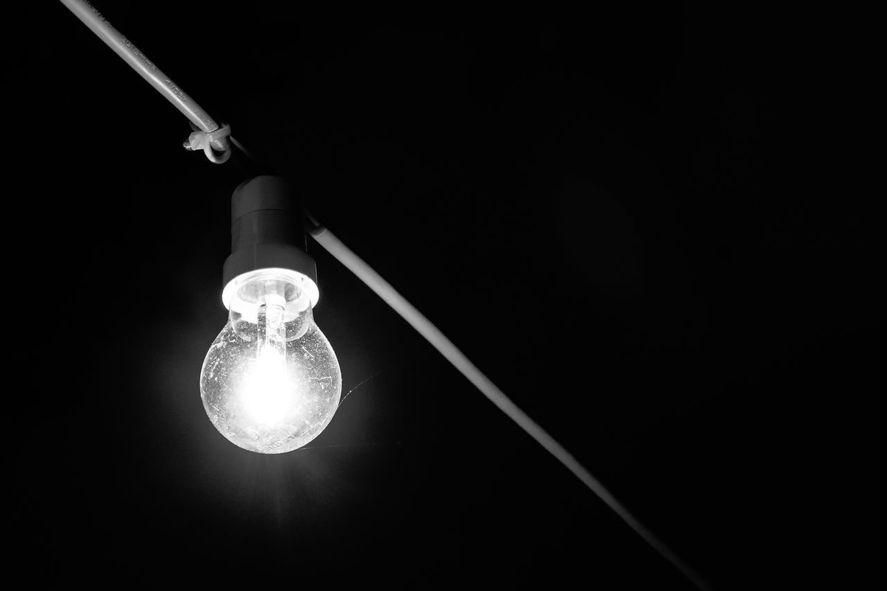 electricity, light bulb, lighting equipment, no people, illuminated, technology, filament, studio shot, black background, fuel and power generation, close-up, hanging, indoors