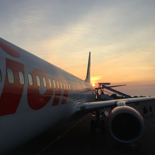 Sunset Transportation Airplane Mode Of Transport Part Of Sun Air Vehicle Sky Orange Color Flying Journey Outdoors Cloud - Sky Sunbeam Scenics Back Lit Tranquil Scene bye bali Bye Bali
