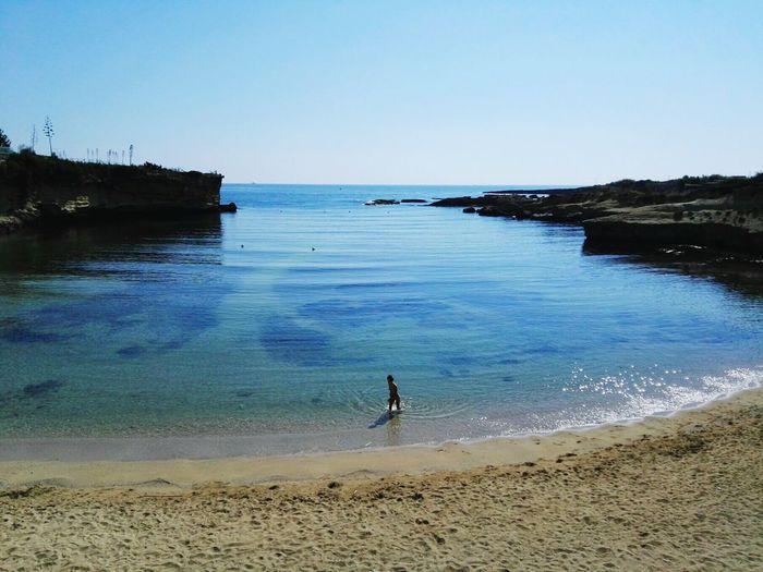 Plemmirio Siracusa Italy Beach Pace Calm Blue Silence Silence Of Nature Water Sea Wave Beach Full Length Sand Clear Sky Men Paddleboarding Sky