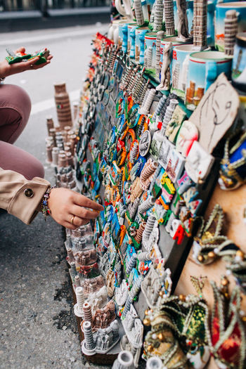 Midsection of woman buying souvenirs