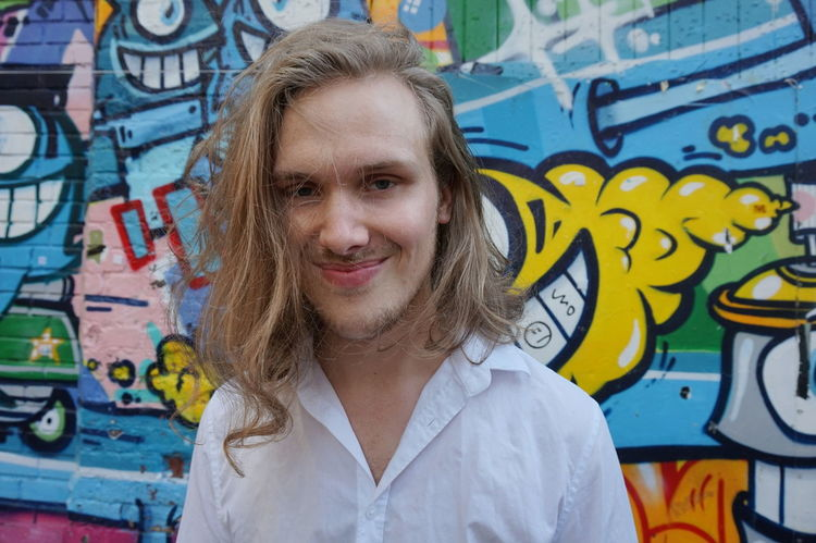 Smiling young man Casual Clothing Colorful Creativity Day Focus On Foreground TakeoverContrast Graffiti People And Places Graffiti Art Handsome Handsome Boy Happy Happy People Headshot Lifestyles Long Hair Looking At Camera Medium-length Hair Outdoors Person Portrait Smiling Smiling Face Young Young Adult Adapted To The City Uniqueness Paint The Town Yellow