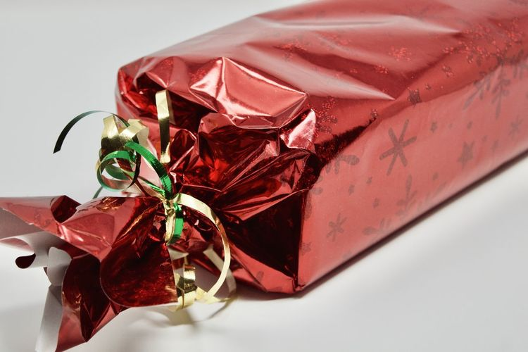Close-up of red wrapped in box on table