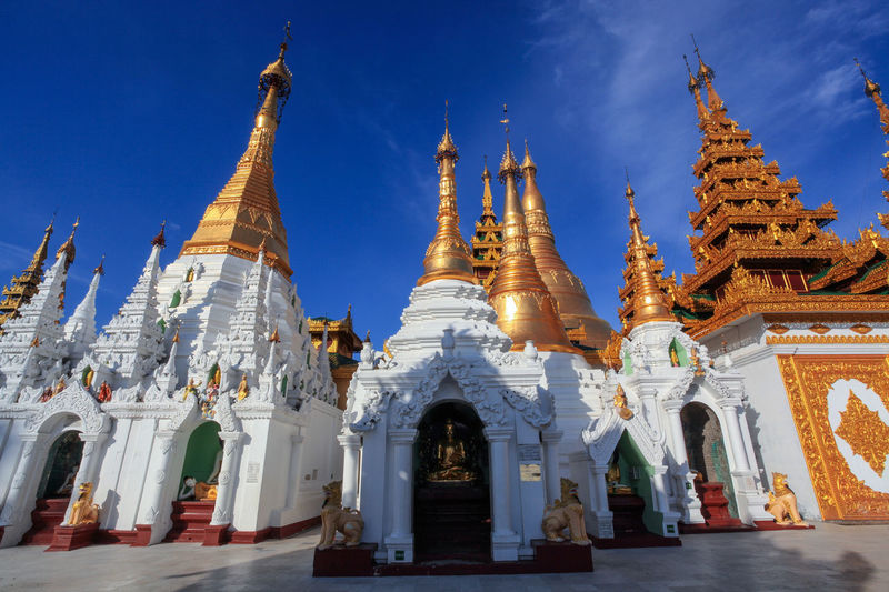 Ancient Architecture Blue Cultures Day Gold Gold Colored Myanmar No People Pagoda Pilgrimage Place Of Worship Praying Religion Shrine Shwedagon Shwedagon Pagoda Sky Spirituality Tourism Travel Travel Destinations