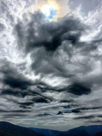 Stormy Clouds over the mountains Sky Cloud - Sky Weather Storm Cloud Nature Storm Beauty In Nature Cloudscape Dramatic Sky Backgrounds Overcast Scenics Meteorology Ominous No People Sky Only Awe Low Angle View Outdoors Thunderstorm