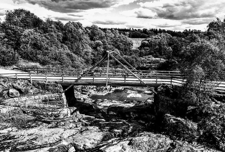 Architecture Beauty In Nature Bridge - Man Made Structure Built Structure Cloud - Sky Connection Day Footbridge Growth Mountain Nature No People Old Bridge Outdoors Rail Transportation Railroad Track River Scenics Sky The Architect - 2017 EyeEm Awards Tranquil Scene Transportation Tree Water