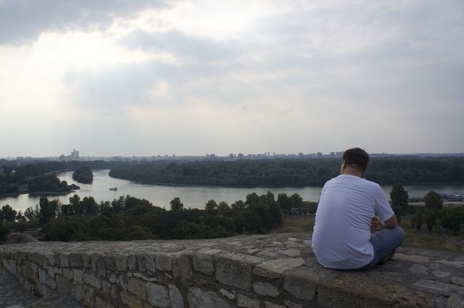 Beauty In Nature Casual Clothing Cloud - Sky Danube Full Length Lake Leisure Activity Lifestyles Looking At View Men Nature Person Rear View Relaxing River Sava River Sitting Sky Standing Tourism Tranquil Scene Tranquility Traveling Water