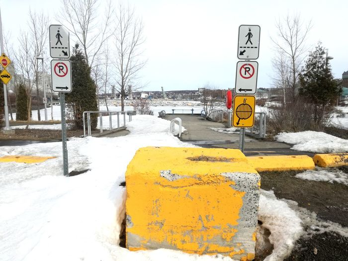 Don't Enter No Trespassing Yellow Color Marina Bay Snow Covered Snow In The City Snow On Road Winter In The City Winter Day Wintertime SnowCollection Urban Photography Road Sign Winter Communication Road Cold Temperature Warning Sign Guidance Do Not Enter Sign Warning Information Stop Sign