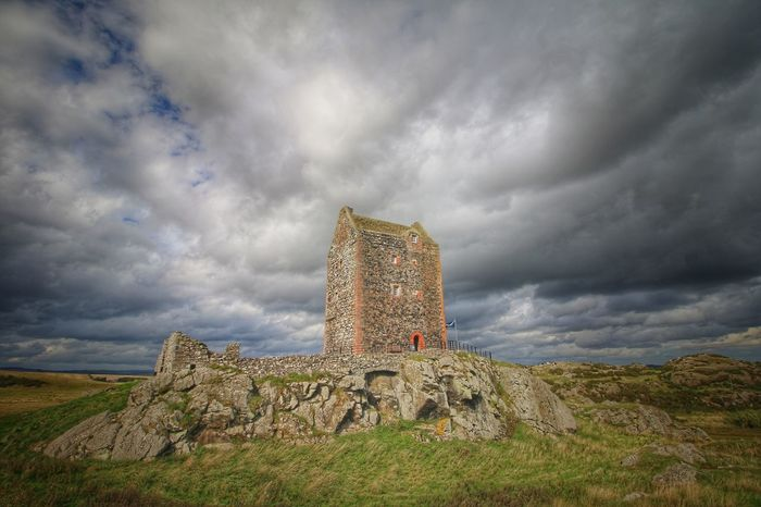Smailholm tower Saltire Scotland Scottish Borders Ancient Architecture Building Building Exterior Built Structure Cloud - Sky Day Deterioration Environment Field Fortified Tower Grass History Land Landscape Nature No People Old Outdoors Plant Ruined Sky Smailholmtower The Past Tower Houses