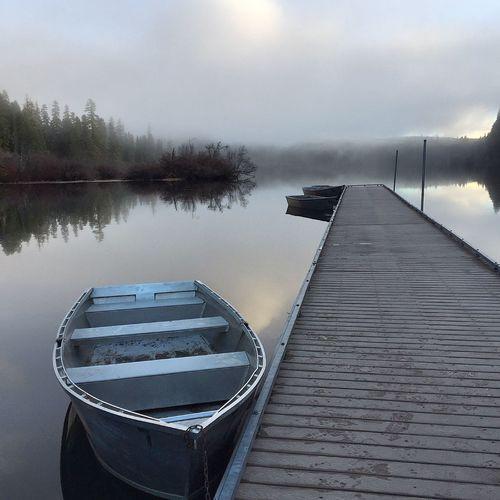 Rowboat Moored At Lake Pier